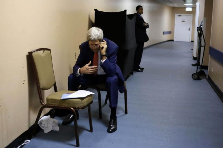 U.S. Secretary of State John Kerry sits in the service hallway of a hotel in Cairo July 25, 2014, as he speaks on the phone with Qatar's Foreign Minister Khaled al-Attiyah about the terms of a ceasefire in Israel's fight against Islamist militants in Gaza, during a break in his meetings with Egypt's Foreign Minister Sameh Shukri and U.N. Secretary-General Ban Ki-moon.