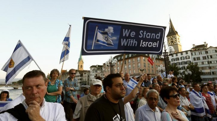 Protesters hold up signs during a demonstration to support Israeli, in Zurich July 31, 2014.   Reuters