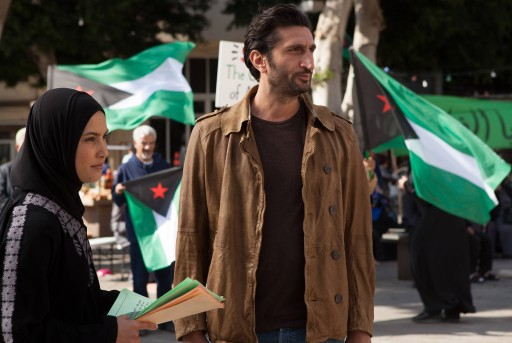 "This photo released by FX shows Mor Polanuer, left, as Samira and Fares Fares, as Fauzi, in a scene from the TV series, ""Tyrant,"" which aired Tuesday, July 15, 2014,  10:00 p.m. ET/PT. Production of FX's series ""Tyrant"" recently relocated from Tel Aviv to Istanbul, showrunner Howard Gordon told a TV Critics' panel Monday, July 21, 2014. (AP Photo/FX, Vered Adir)"