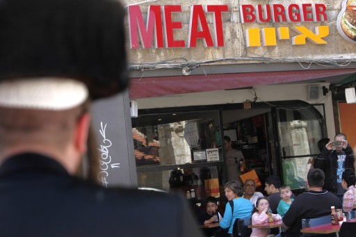 FILE - Ultra orthodox Jew outside a fast food restaurant in the center of Jerusalem, April 24, 2011. Photo by Miriam Alster/FLASh90