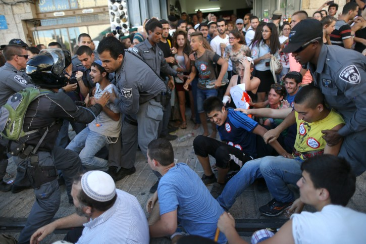 Israeli police clash with rightwing protesters during a large protest against Arab terrorism in central Jerusalem, on July 1, 2014, in response to the kidnap and murder of three Jewish teens.(Flash90)