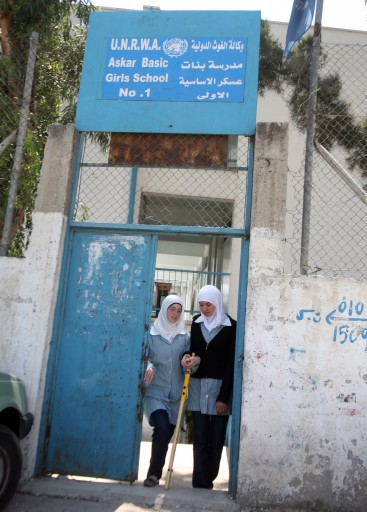 FILE - Palestinian students leave their girls School, run by UNRWA, in in the city of Gaza.