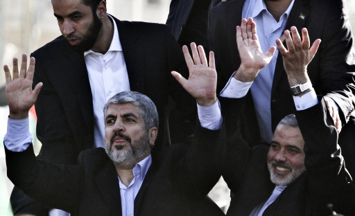 FILE - Hamas leader Khaled Meshaal (C) and Hamas Prime Minister, Ismail Haniyeh (C-R) wave from the rooftop of a vehicle following Meshaal's arrival through the Egyptian-Gaza border in Rafah, Gaza Strip, 07 December 2012.  EPA