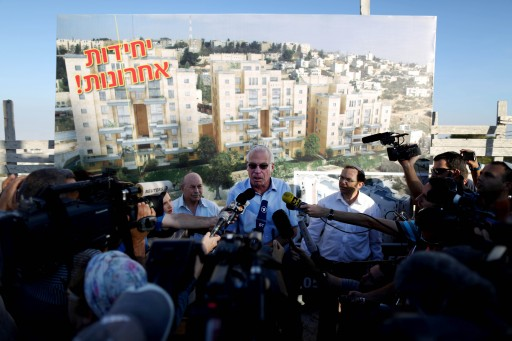 FILE - Israeli Housing Minister Uri Ariel speaks to reporters at a ceremony announcing the resumption of construction of an Israeli neighbourhood in East Jerusalem August 11, 2013. EPA