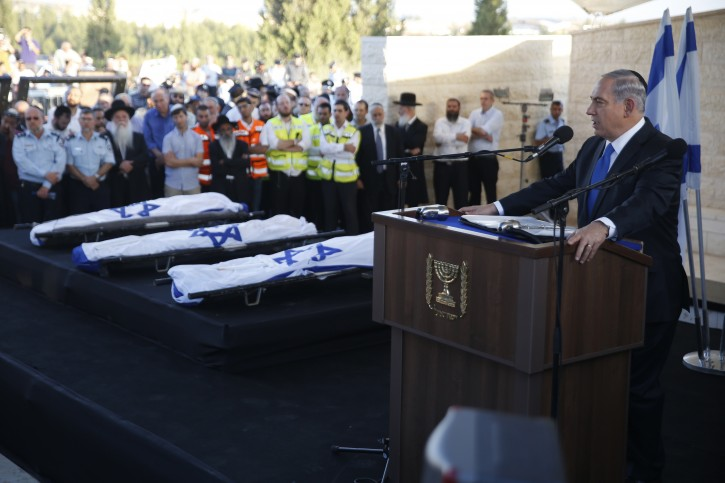 Israeli Prime Minister Benjamin Netanyahu (R) eulogizes three Israeli teens who were abducted and killed in the occupied West Bank, Gil-Ad Shaer, US-Israeli national Naftali Fraenkel, both 16, and Eyal Yifrah, 19, during their joint funeral in the Israeli city of Modi'in, 01 July 2014. EPA