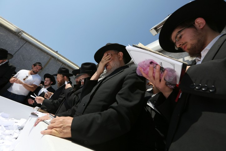 People visit the grave site of the late Lubavitcher Rebbe, Rabbi Menachem Mendel Schneerson, at the Montefiore Cemetery in the Cambria Heights section of Queens, New York, New York, USA, 01 July 2014.