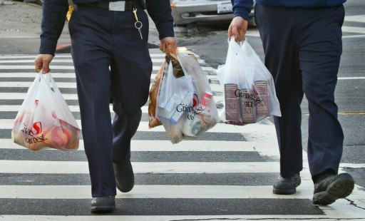 File: Men carry plastic grocery bags in San Francisco, California. REUTERS/Kimberly White/Files