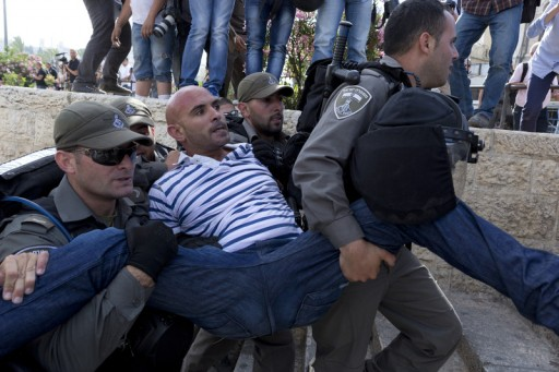 File: A Palestinian man is carried away under arrest by Israeli Police during clashes in East Jerusalem. EPA/JIM HOLLANDER