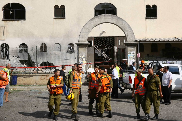 Israeli forces at the site of where a rocket landed at a synagogue inthe southern Israeli town of Ashdod on August 22, 2014. Photo by Flash90