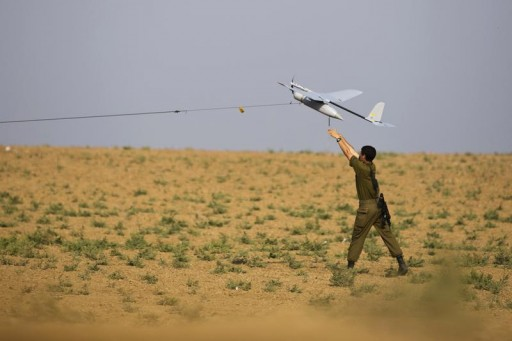 FILE - An Israeli soldier launches a drone outside the Gaza Strip July 22, 2014.  Reuters