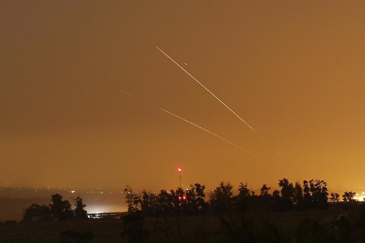 Light streaks and trails are seen as rockets are launched from Gaza towards Israel before a 72-hour cease fire was due to expire August 13, 2014. REUTERS