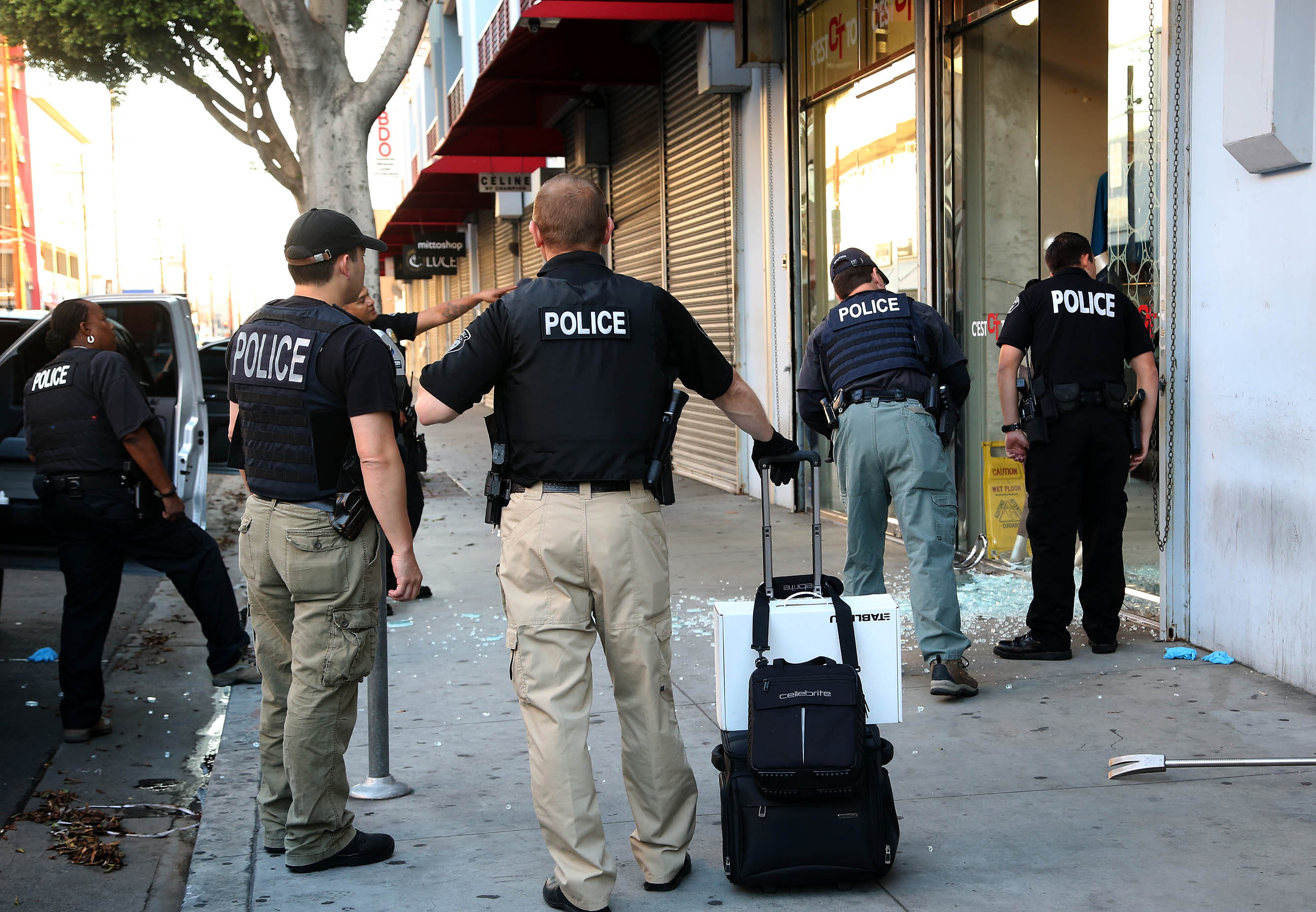 Law Enforcement Agents Stand Outside A Clothing During Raid In The Los Angeles Fashion
