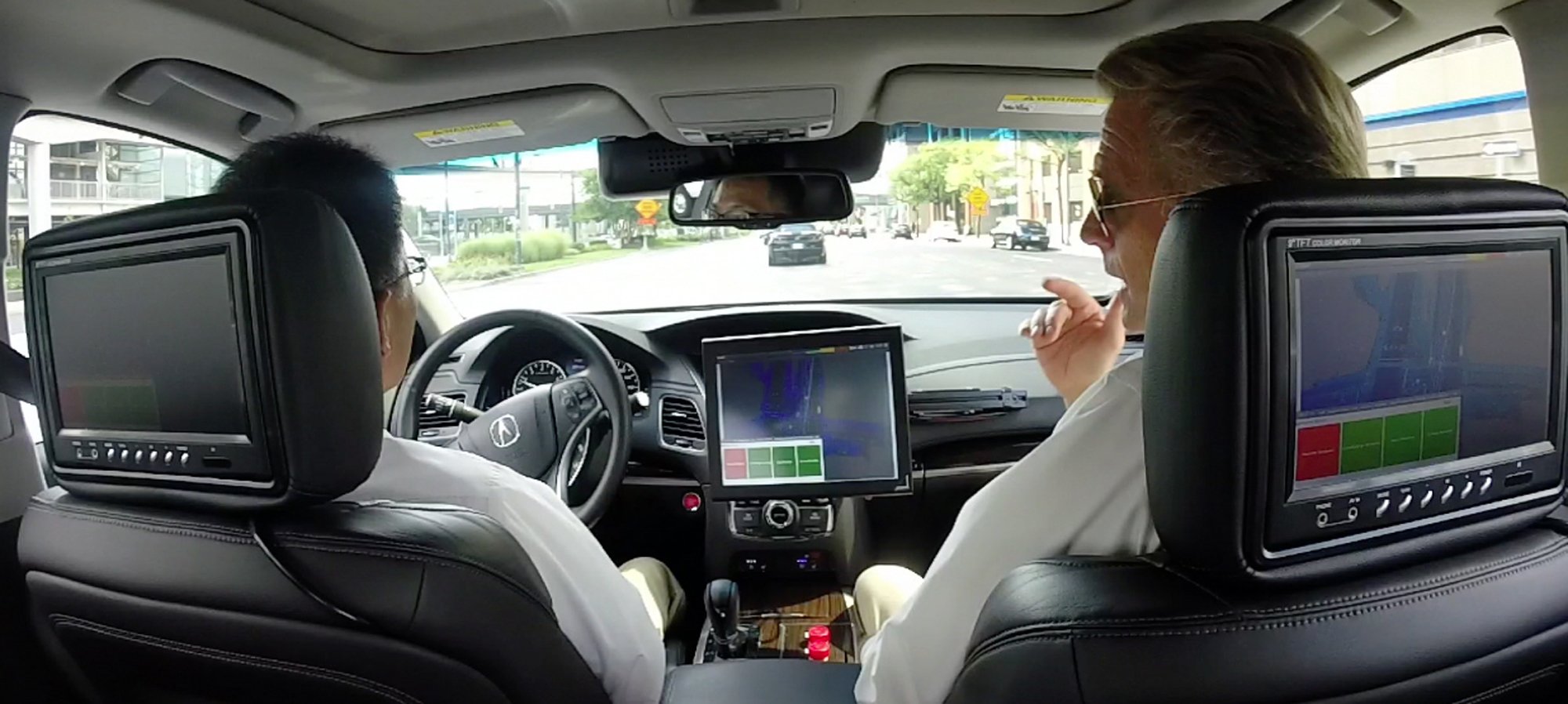 Peter Carey Right Talks During A Driving Demonstration In Prototype Acura Rlx Sedan