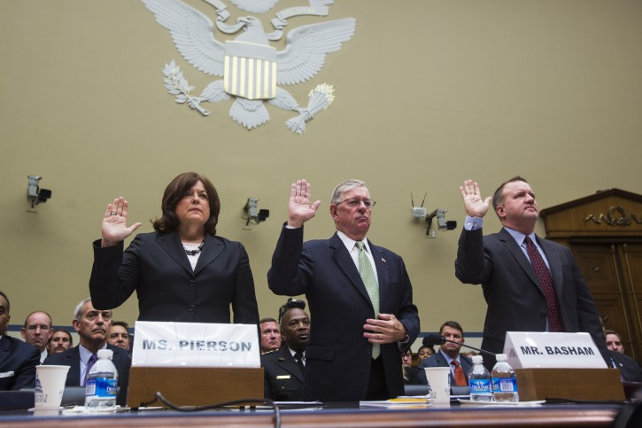 epa04424723 US Secret Service Director Julia Pierson (L), along with former us Secret Service Director W. Ralph Basham (C) and former Assistant Homeland Security Secretary for Infrastructure Protection Todd Keil (R), are sworn in prior to testifying before a House Oversight and Government Reform Committee hearing about the intruder who made into the East Room of the White House after scaling a fence, in the Rayburn House Office Building in Washington, DC, USA, 30 September 2014.EPA