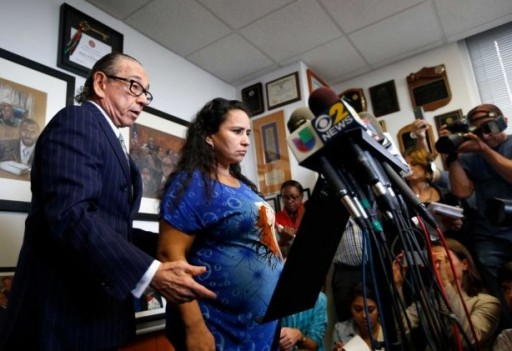 FILE - Attorney Sanford A. Rubenstein, left, introduces client Sandra Amezquita, 43, who is 5 months pregnant, during a press conference at his offices in New York, Wednesday, Sept. 24, 2014. Amezquita, who was caught on amateur video showing a New York police officer taking her to the ground on her stomach as she tried to intervene in the arrest of her 17-year-old son early Saturday morning, Sept. 20, in Brooklyn, and a woman who says she tried to come to Amezquita's aid, have requested a criminal investigation regarding the officer's actions. (Kathy Willens, AP / AP)
