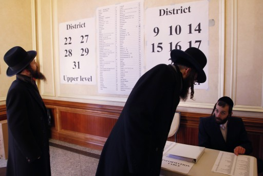 FILE - Two voters arrive at a polling station, Tuesday, Nov. 2, 2010 in Kiryas Joel, N.Y.  AP
