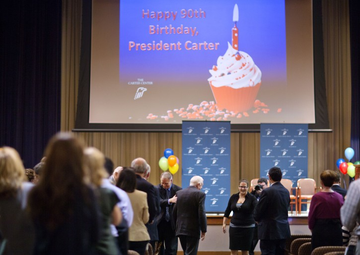 Former President Jimmy Carter, center, walks through the crowd as he takes his seat for his 90th birthday celebration, Wednesday, Oct. 1, 2014, in Atlanta. (AP Photo/David Goldman)