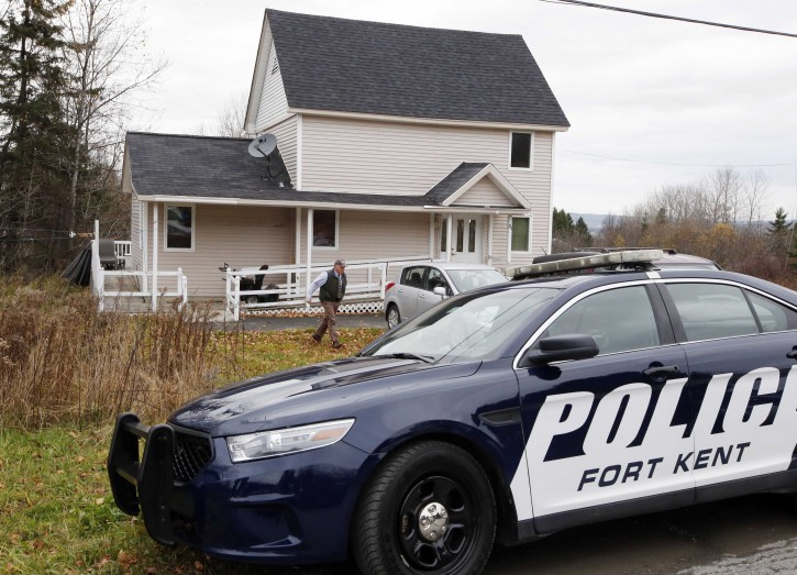 Fort Kent Police Chief Thomas Pelletier leaves the home of nurse Kaci Hickox after a brief visit, Friday, Oct. 31, 2014, in Fort Kent, Maine. State health officials have asked a court to limit the movements of Hickox, who defied a voluntary quarantine for medical workers who have treated Ebola patients. Officials filed documents Thursday, following through with a threat to try to isolate her.( AP Photo/Robert F. Bukaty)