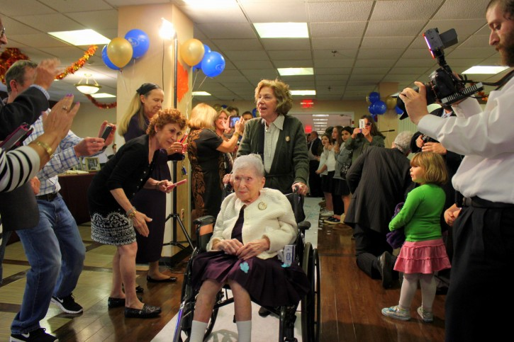 Goldie's daughter Anne wheels Goldie down the white carpet to begin the celebration of her 114th Birthday at Grandell Rehab Center. Credits: Roy Renna / BMR Breaking News