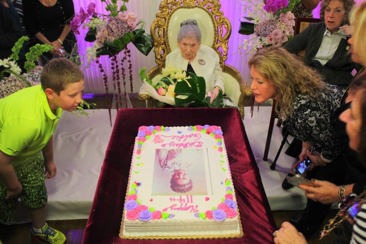 Oct. 30, 2014 - Family members of 114 year old Goldie blow out the candles on her cake. Credits: Roy Renna / BMR Breaking News