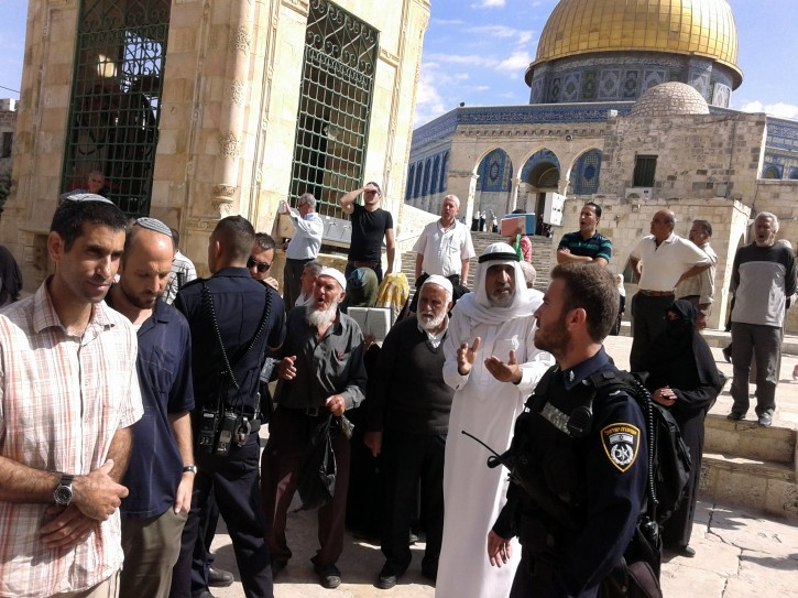 Palestinians protesting to Israeli police as religious right-wing Jews, part of a larger group, tour the Temple Mount, or the Hareem el-Sharif (The Noble Sanctuary) to the Moslem world, in the Old City of Jerusalem, 01 October 2014. EPA