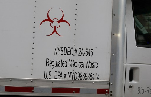 FILE - Police and Health officials arrive in a medical waste containment truck at the home of Dr. Craig Spencer, who has been diagnosed with the Ebola virus in New York City, New York, USA 24 October 2014. EPA