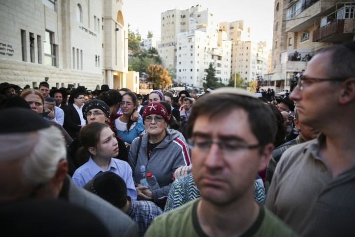 Hundreds attend the funeral ceremony of three out of the four victims who were murdered by two Palestinians at a synagogue in the Ultra-Orthodox Har Nof neighbourhood in Jerusalem on November 18, 2014. flash90