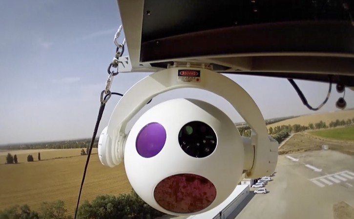 In this image made from undisclosed and undated video provided by RT LTA Systems Ltd. via AP video, a camera on a surveillance balloon flies over land. The Israel-based RT LTA Systems Ltd. that makes the Skystar 180 aerostat system said the balloons can stay in the air for 72 hours and carry sensitive cameras meant to assist security forces in their daily work. (AP Photo/RT LTA Systems Ltd. via AP video)