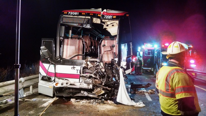 This photo provided by the Onondaga County Sheriff's Office shows the bus involved in a crash with a tractor-trailer and a car that left 27 people injured  on Interstate 81 early Thursday, Nov. 6, 2014, in Nedrow, N.Y. AP