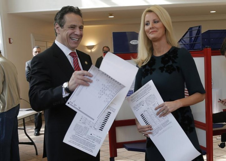 Democratic New York Governor Andrew Cuomo and his girlfriend Sandra Lee hold their ballots as they cast their votes at the Presbyterian Church in the town of Mount Kisco, New York, November 4, 2014. Reuters