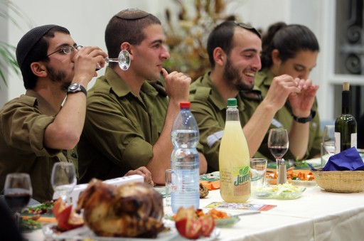 File photo of Israeli army enjoying a Thanksgiving dinner meal in Jerusalem on 25 November 2010. EPA/JIM HOLLANDER