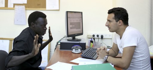 File: An African migrant from South Sudan is being interviewed by an inspector of the Immigration and Population Department, after being arrested, at the Immigration and Population office near Tel Aviv, Israel, 12 June 2012. EPA/ABIR SULTAN
