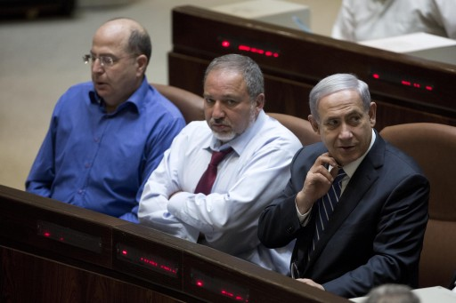FILE -  Israeli Prime Minister Benjamin Netanyahu (R), Israeli Foreign Minister Avigdor Lieberman (C) and Israeli Defense Minister Moshe Ya'alon (L) attend the 2015 budget voting at the Israeli Knesset plenum in Jerusalem, Israel, 10 November 2014. Media reports on the possibility of early primaries due to controversies between the parties of the Israeli Parliament.  EPA/ABIR SULTAN