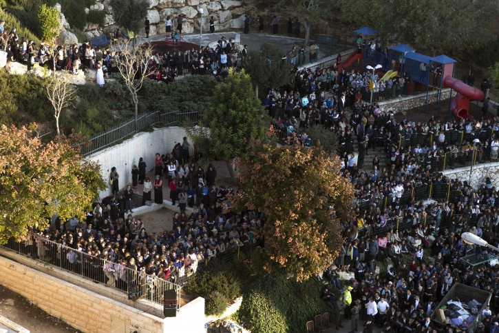 A children's park is filled with religious Jewish women attending the funeral services late in the afternoon for Aryeh Kupinsky, Rabbi Avraham Shmuel Goldberg and Rabbi Kalman Levine, who were slain by two Palestinians who attacked a synagogue in the Har Nof religious neighborhood in Jerusalem, 18 November 2014. EPA