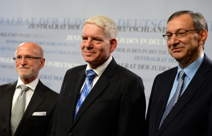 Josef Schuster (C), newly elected President of the Central Committee of Jews in Germany and his deputy Mark Dainow (L) and Abraham Lehrer look into the round in the Ignatz-Bubis-Community Center in Frankfurt Main, Germany, 30 November 2014. Schuster has been elected as President for a term of four years at the council meeting.  EPA/ARNE DEDERT