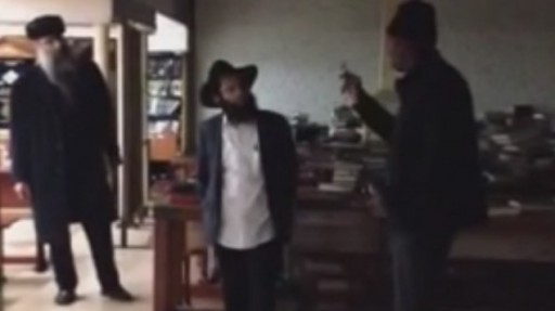 The suspected right inside the Chabad headquarters in Crown Heights, Brookly, NY, December 9, 2014. (Screenshot capture: YouTube)
