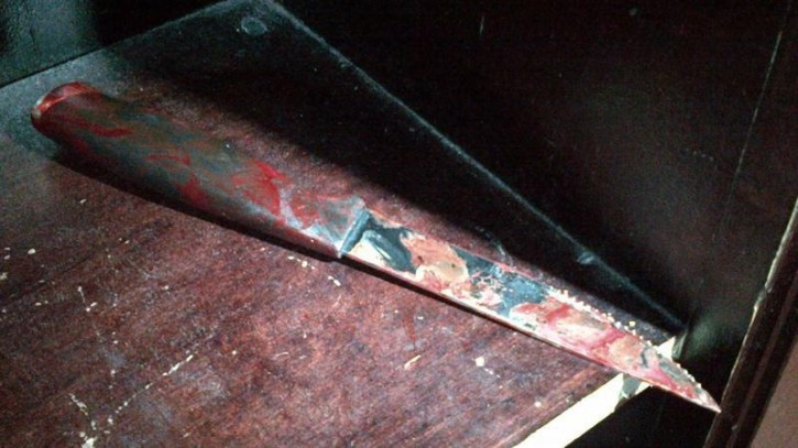 A blood-stained nine-inch (23 cm) knife is seen after being recovered at the scene of a stabbing at a Brooklyn synagogue, in a picture provided by the New York Police Department December 9, 2014.