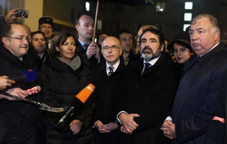 French Interior Minister Bernard Cazeneuve (C) and Paris Mayor Anne Hidalgo (front row, 2nd L) arrive at the end of a demonstration at the end of Shabbat called by the Union of French Jewish Students (UEJF) near the kosher supermarket where an attack was carried out earlier this week, near Porte de Vincennes in eastern Paris January 10, 2015. Reuters