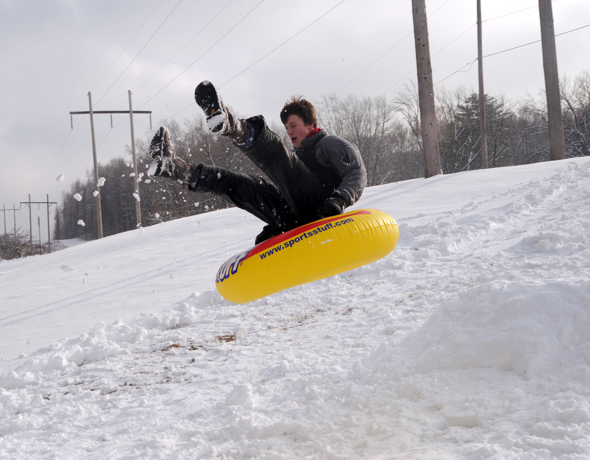 File Photo Of A Teen Riding On A Snow Tube As He Launches Off Of A