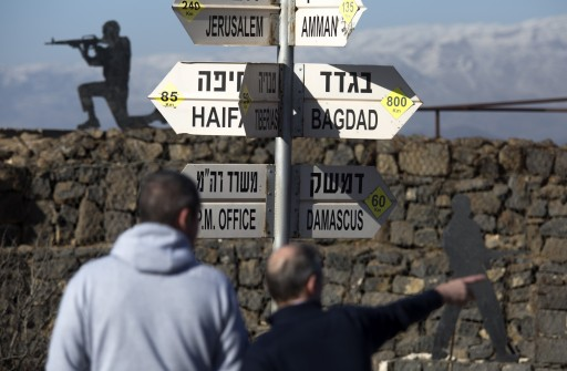 File: Visitors point toward Damascus as they visit the Merom Golan lookout position in the Golan Heights, 23 January 2015. EPA/JIM HOLLANDER