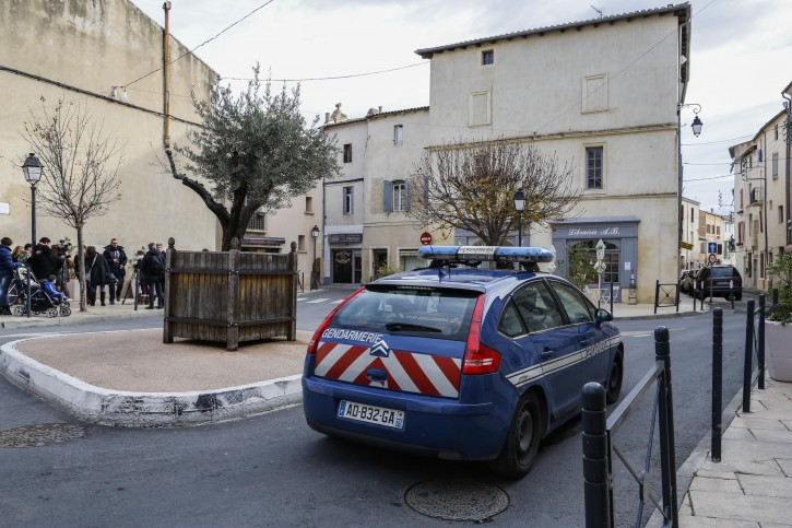 Police officers and members of press stand outside a building in the center of Lunel, southern France, 27 January 2015. EPA/ARNOLD JEROCKI