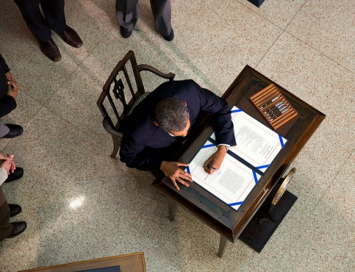 File: President Obama as he signed a bill at Jan. 17, 2014. (Official White House Photo by Lawrence Jackson)