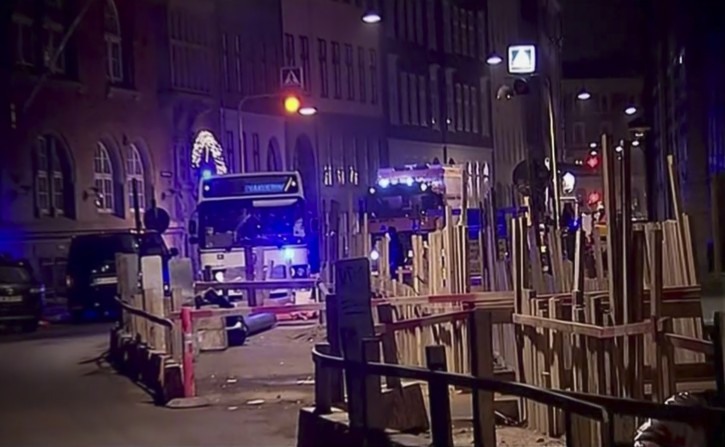 This image made from TV2 via Associated Press News video shows the scene near a synagogue where police reported a shooting in downtown Copenhagen, Denmark, Sunday, Feb. 15, 2015.  One person was shot in the head and two police officers were shot in the arms and legs, police said. (AP Photo/TV2 via APTN