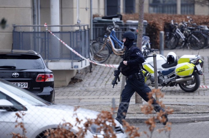 "An armed security officer runs down a street near a venue after shots were fired where an event titled  ""Art, blasphemy and the freedom of expression"" was being held in Copenhagen, Saturday, Feb. 14, 2015. AP"