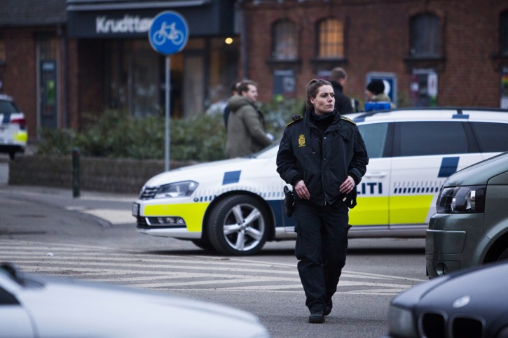 "A security officer patrols outside a venue after shots were fired where an event titled ""Art, blasphemy and the freedom of expression"" was being held in Copenhagen, Saturday, Feb. 14, 2015.  AP"