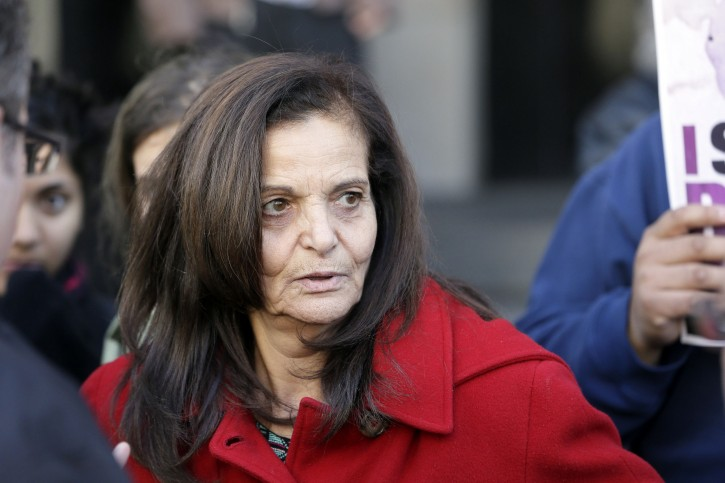 FILE - In this Nov. 10, 2014, file photo, Rasmieh Odeh, of Chicago, is interviewed outside federal court in Detroit. A federal judge in Detroit has denied a request for a new trial for Odeh convicted of lying about her role in two terrorist bombing deaths in Israel when she immigrated to the U.S. Her sentencing is scheduled for March 12, 2015. (AP Photo/Carlos Osorio, File)