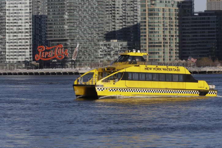 In this Thursday, Feb. 5, 2015, photo a commuter ferry travels on the East river from Long Island City in the Queens borough of New York to the 34th Street Pier in Manhattan. New York City Mayor Bill de Blasio plans to bring ferry service to some of New York City's waterfront neighborhoods.(AP Photo/Mary Altaffer)