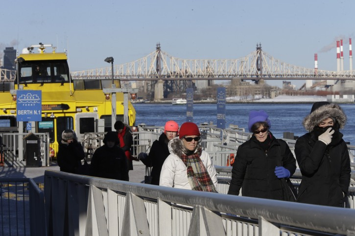 In this Thursday, Feb. 5, 2015, photo commuters disembark from a ferry at the 34th Street pier in Manhattan. New York City Mayor Bill de Blasio plans to bring ferry service to some of New York City's waterfront neighborhoods.(AP Photo/Mary Altaffer)