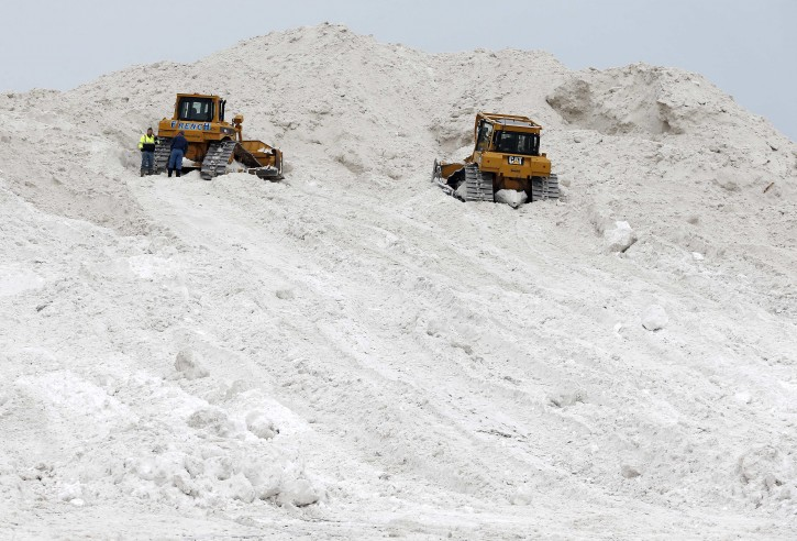 "A pair of bulldozers sit on a giant snow pile at a ""snow farm"" in Boston, Saturday, Feb. 14, 2015. Crews from around the region have worked urgently to remove the massive amounts of snow that has clogged streets and triggered numerous roof collapses ahead of yet another winter storm due to arrive on Saturday. (AP Photo/Michael Dwyer)"