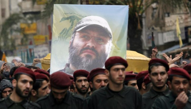 FILE - Lebanon's Hezbollah guerrillas carry a poster and the coffin of their assassinated commander Imad Moughniyah during his funeral in Beirut's suburbs February 14, 2008.  Reuters